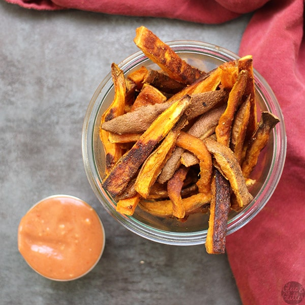 Need a way to spice up your sweet potatoes? Curried sweet potato oven fries to the rescue! They're perfect dipped in creamy cumin ketchup.