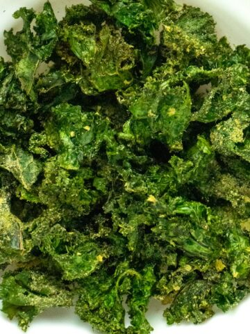 close-up of a bowl of air fryer kale chips with ranch seasoning
