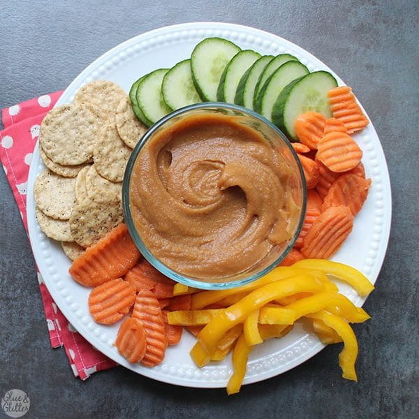 Spicy Peach BBQ Hummus is perfect for dipping chips or your favorite veggies. It only takes 4 ingredients and 5 minutes to make! #GameDayGreats #ad