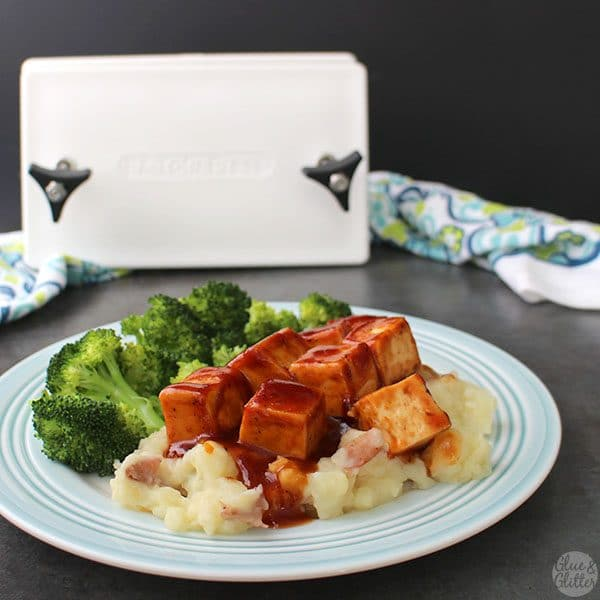 Sweet-and-sticky baked BBQ tofu is perfect parked next to your favorite green veggie on top of a bed of fluffy mashed potatoes.