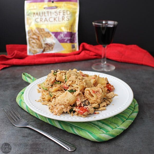Cozy, baked rigatoni pasta casserole packed with tomato and zucchini goodness and topped with crunchy cracker crumbs. #CrunchmasterDinner