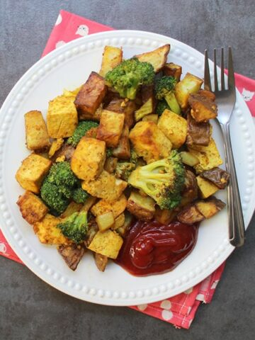 overhead photo of the air fryer tofu scramble with potato and broccoli with a side of ketchup