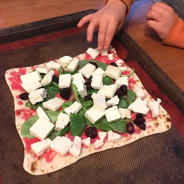 Kid-made vegan pizza with ginger cranberry dressing!
