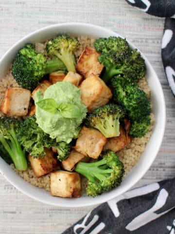 photo of a tofu and broccoli bowl with quinoa and pesto