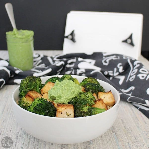 in a white bowl quinoa bowl with tofu, broccoli, and oil-free pesto