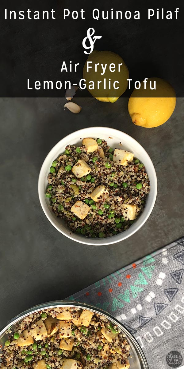 bowl of quinoa with peas and tofu next to garlic cloves and lemons