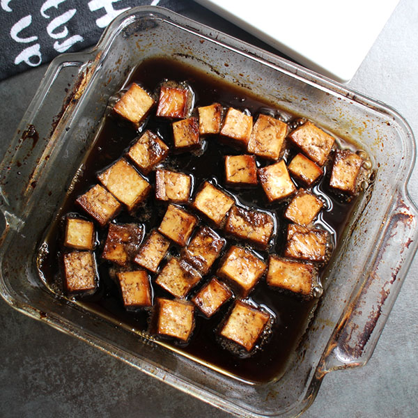 Maple-Balsamic Tofu, in a baking pan, fresh out of the oven