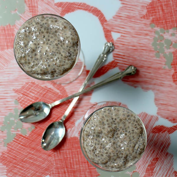 two chai puddings on a floral background with spoons