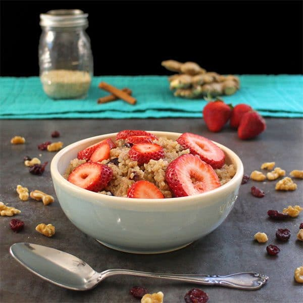 bowl of quinoa porridge with strawberries