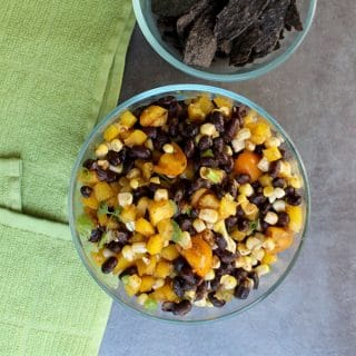 Serve up your Black Bean Taco Salad as a tasty one-bowl meal over rice or quinoa or stuffed into a taco or burrito. You only need eight ingredients and half an hour to make it.