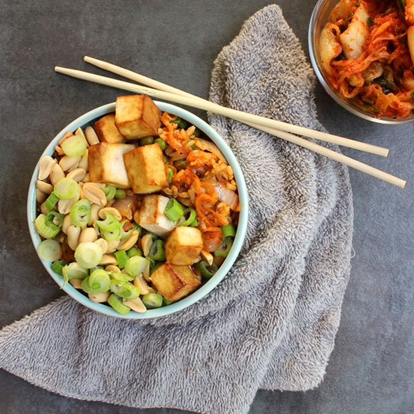 Make this vegan Kimchi Fried Rice as hot (or not) as you like! This flexible recipe is great for using up leftover rice to make supper in a hurry.