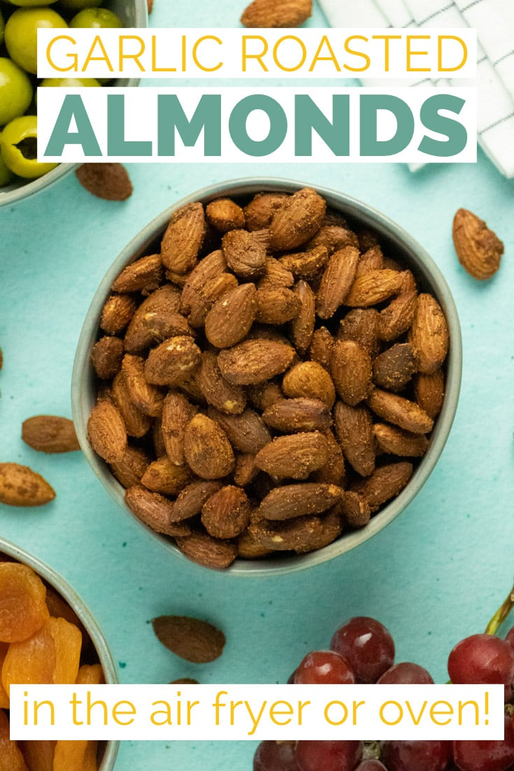 bowl of air fryer garlic almonds on a party spread
