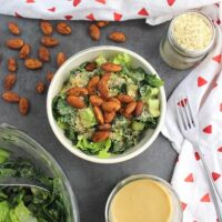 "Easy, delicious Kale Caesar Salad with Garlic Almond ""Croutons"" can be a side dish or a meal, depending on how much you dish into your bowl."
