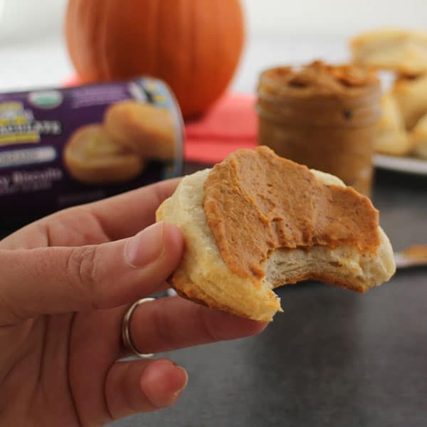 Pumpkin Spice Almond Butter is going to be your new favorite fall spread, and it's perfect slathered onto flaky biscuits.