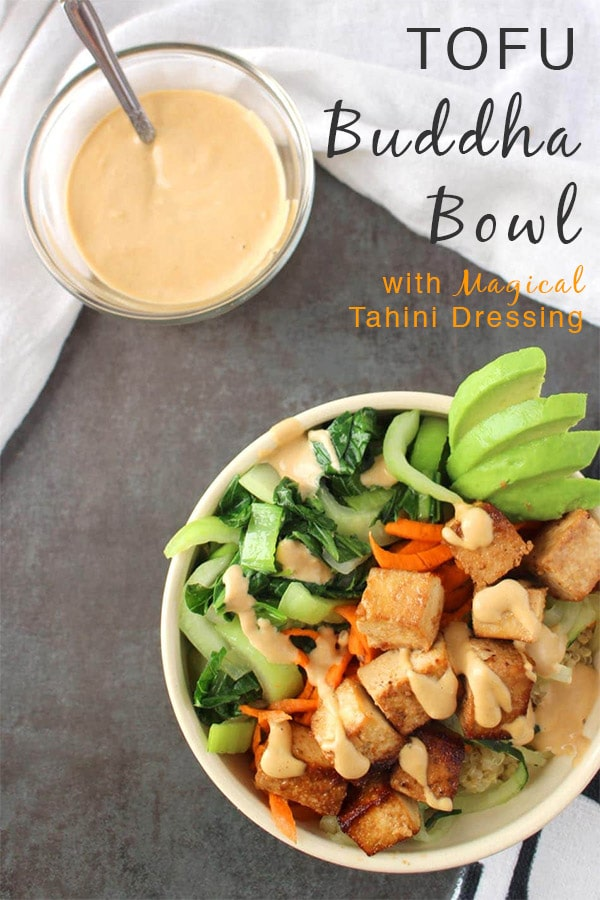 Baked Tofu Buddha Bowls - Firm, flavorful tofu baked to perfection on a bed of quinoa with a mix of fresh and cooked veggies. Top it off with creamy, Magical Tahini Dressing for an easy, satisfying meal in a bowl.