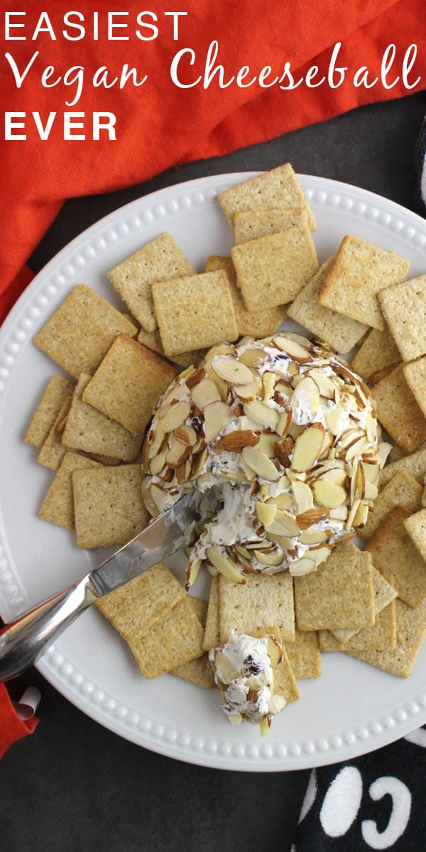 close-up of a vegan cheese ball on a plate with crackers