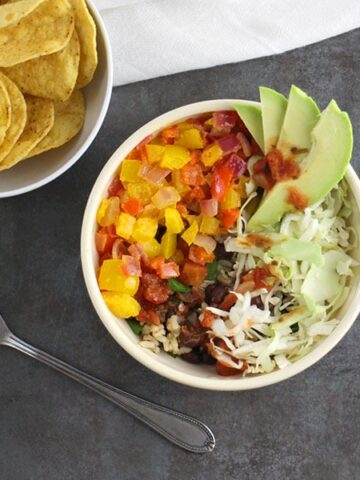 Tangy, slightly spicy, and so, so easy. This flavor-packed Chipotle-Lime Burrito Bowl is going to knock your socks off!