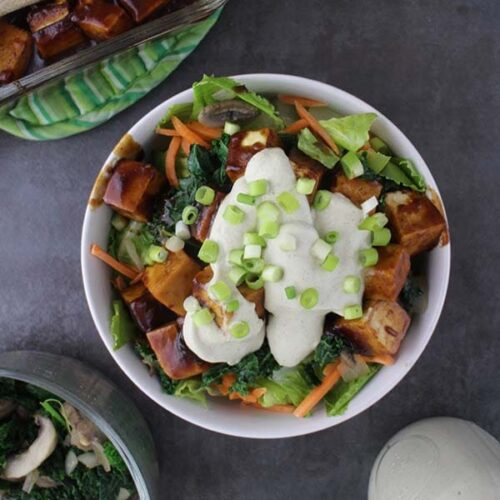 Warm Romaine Salad topped with BBQ Baked Tofu and creamy, homemade Tahini Ranch Dressing is a healthy-yet-hearty meal.