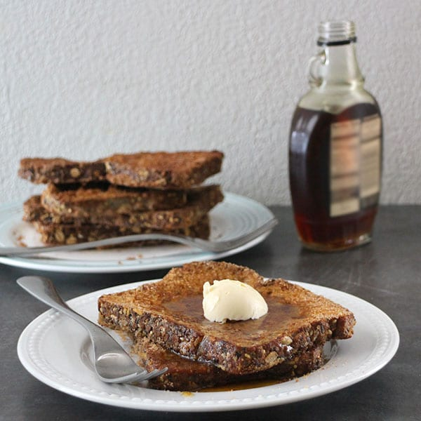 plate of cinnamon french toast with vegan butter and maple syrup