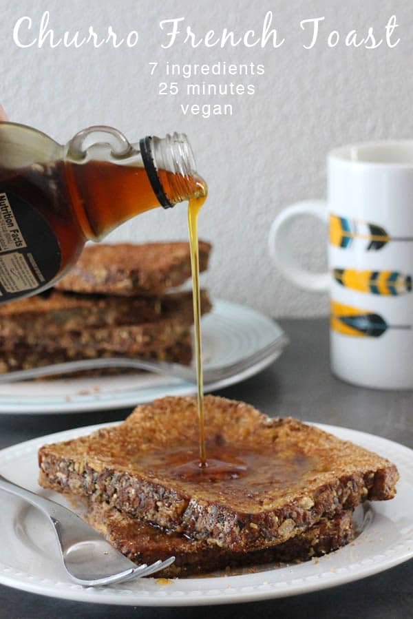 Pouring syrup onto a plate of Vegan Churro French Toast. Coffee mug with colorful feathers on it in the background.