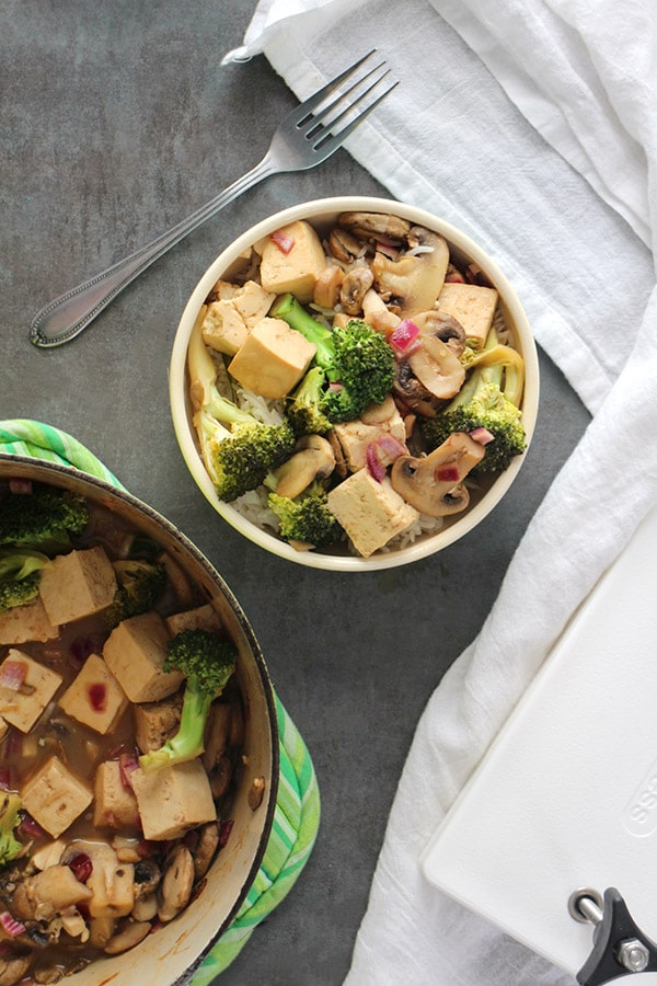 Baked Tofu Stir Fry in a bowl with serving dish next to it.