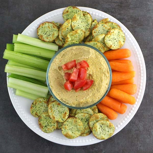 overhead shot of dip with carrots, celery, and crackers.