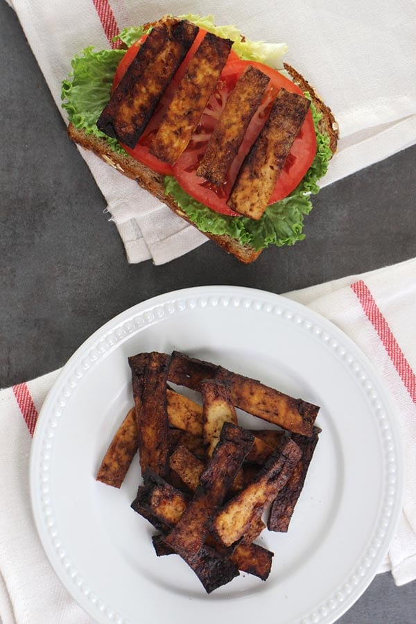 Balsamic Tofu Bacon is sweet, smoky, salty, and delicious anywhere that you'd use bacon. Serve it up as slices alongside a tofu scramble, stuffed into a breakfast sandwich, or diced up over a salad.