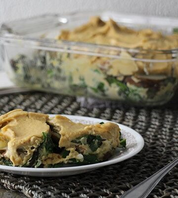 serving of vegan potatoes au gratin with collards on a small plate