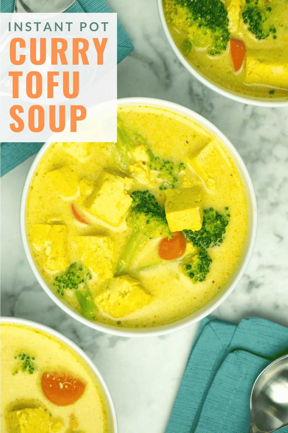 bowl of Instant Pot curry soup on a marble table, text overlay