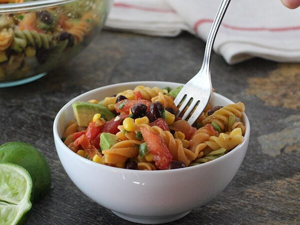This quick and easy Southwest Pasta Salad couldn't be simpler. It tastes even better the next day, so it's a great make-ahead for picnics and parties.