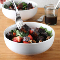 Extra firm, pressed tofu marinated and baked in Maple-Balsamic Sauce is the star of this flavorful Strawberry Spinach Salad.