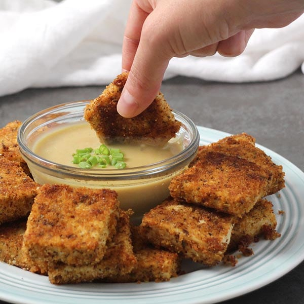 Crunchy Vegan Chicken Nuggets are a crowd-pleasing, kid-friendly delight dipped in Vegan 'Honey' Mustard sauce!