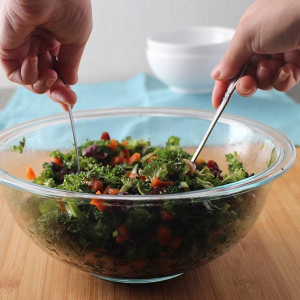 serving broccoli salad from a glass bowl