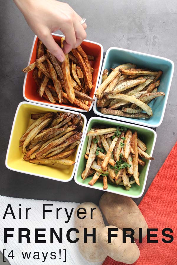 close-up of air fryer french fries in a colorful serving tray with a hand taking a BBQ fry