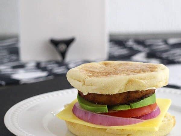 tofu breakfast sandwich on a white plate