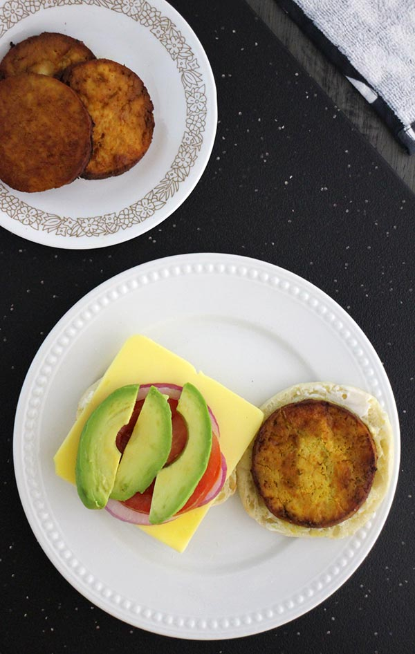"""This super easy vegan breakfast sandwich stars a marinated tofu """"egg"""" and fresh sliced avocado on an English muffin. Make the tofu in the oven or your air fryer!"""
