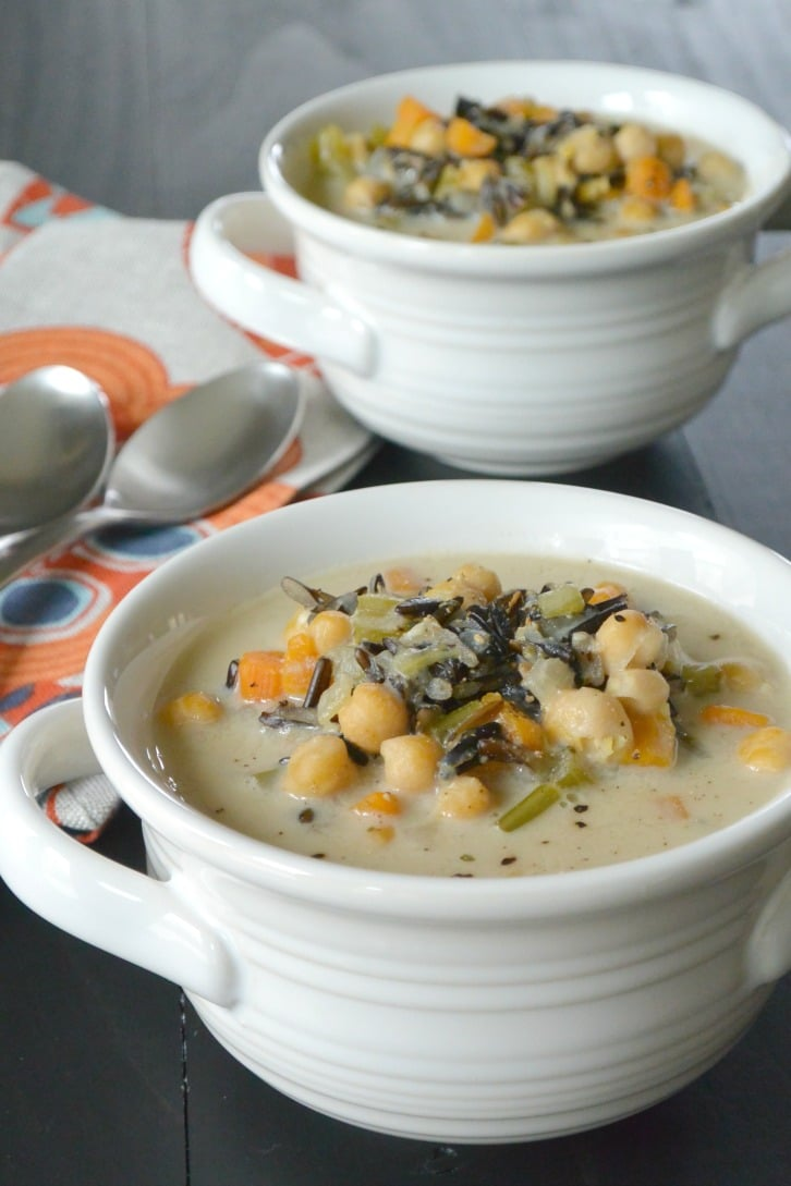 Two white bowls of Vegan Instant Pot Soup with Wild Rice from Veggies Save the Day