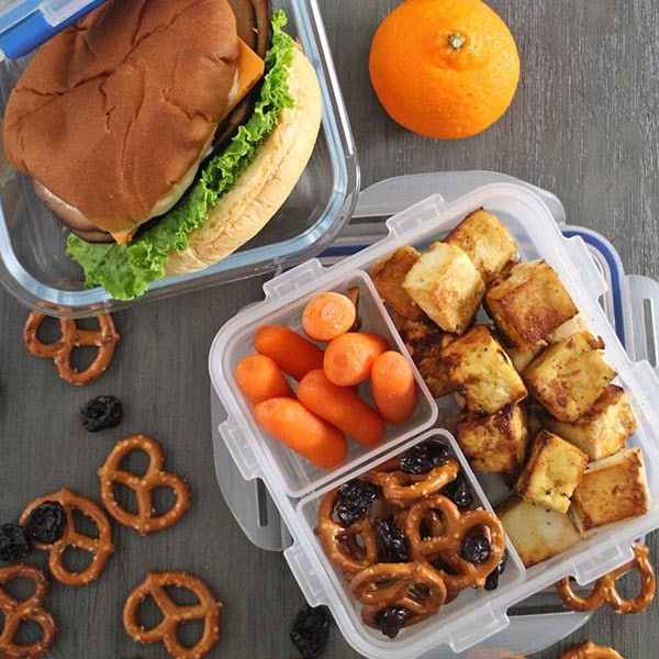 overhead shot of a vegan packed lunch for a kid and one for an adult