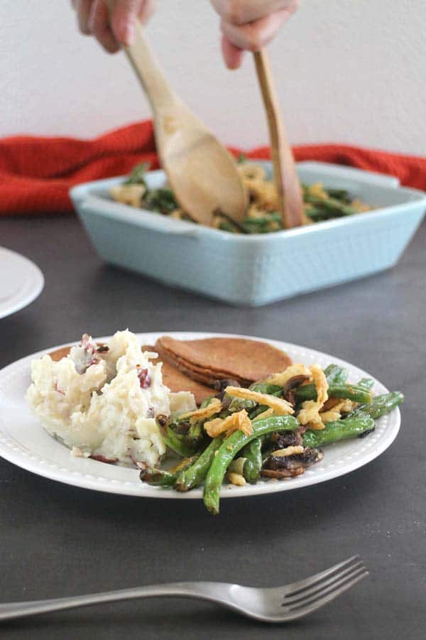 white plate with mashed potatoes, vegan roast and air fryer green beans
