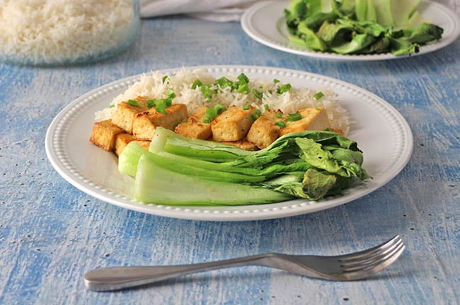 air fryer baby bok choy on a white plate with tofu and rice