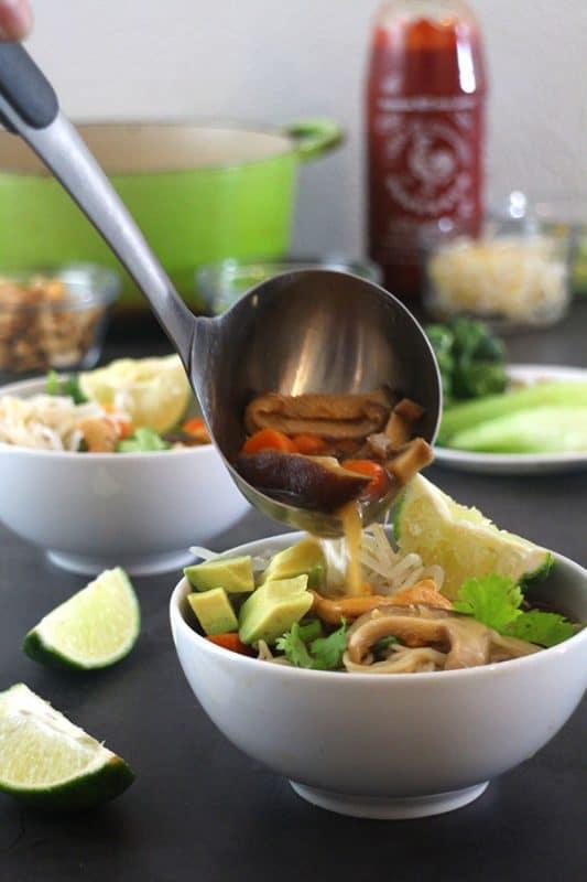 ladling vegan ramen into a bowl