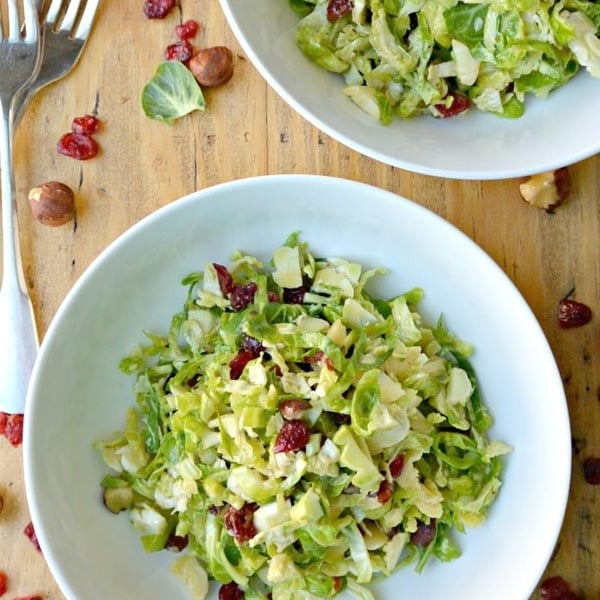 Shaved Brussels Sprouts Salad with Hazelnuts and Dried Cranberries from Veggies Save the Day
