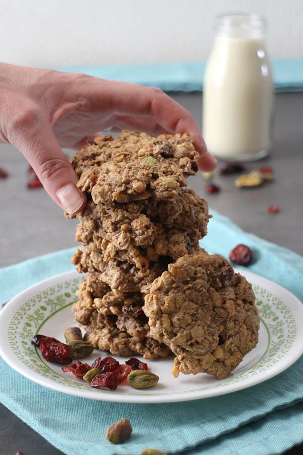 grabbing a cookie from a stack of hearty breakfast cookies