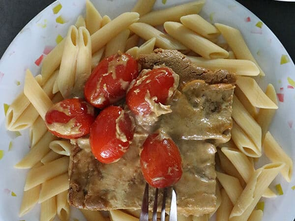 A plate of creamy balsamic tofu and tomatoes