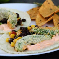 avocado tacos on a plate with corn chips