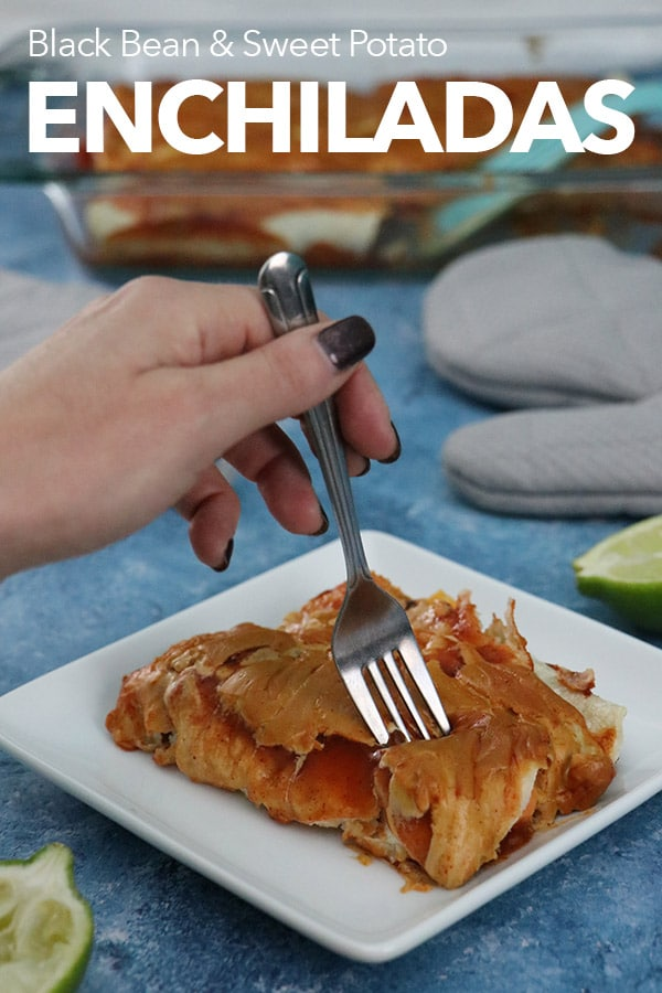 taking a bite of enchiladas