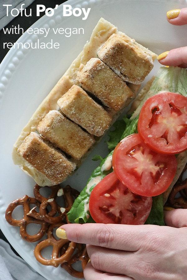 Closing a vegan po'boy sandwich on a plate