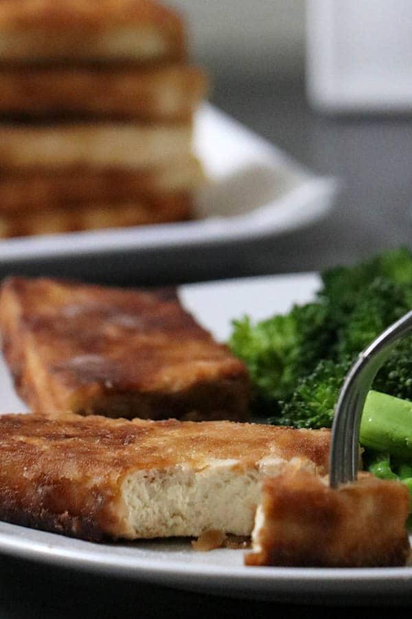 fork taking a bite of stir fried tofu