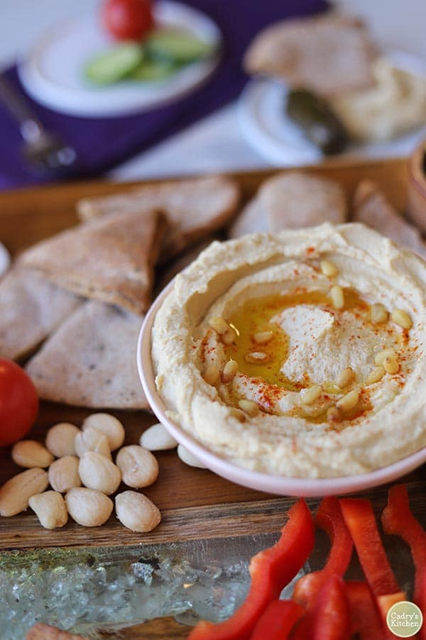 platter of Cadry's Kitchen's hummus with pita, almonds, and red bell pepper