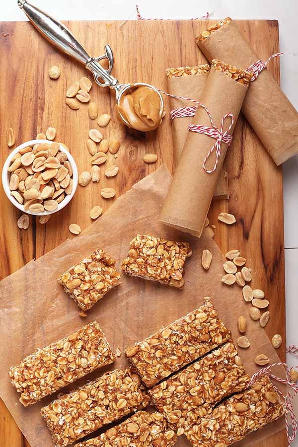 wooden cutting board with ingredients for an a finished batch of My Darling Vegan's peanut butter granola bars